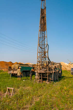 Geologists conduct core drilling of wells for operational geological exploration of useful reserves - refractory clays and kaolin. Zaporizhzhya region, Ukraine. June 2012