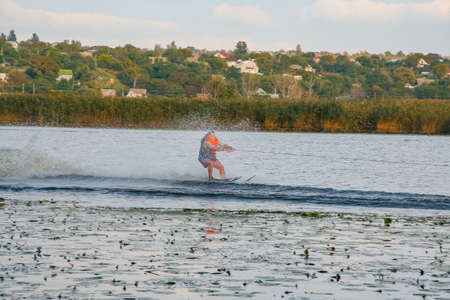 A man waterski on the Kushugum River (a tributary of the Dnipro River). Zaporizhzhya region, Ukraine. September 2012