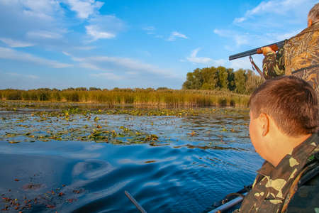 Hunters hunt ducks in the Kushugum floodplains on the Dnipro River. Zaporizhzhya region, Ukraine. September 2012