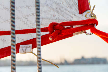 Attaching the sail of the yacht. Black Sea, Odessa, Ukraine. September 2014