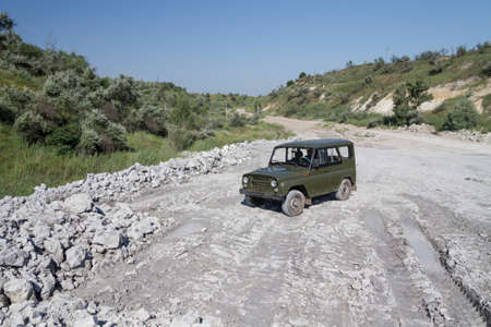 Off-road vehicle in a clay quarry on a winter day. Zaporozhye region, Ukraine. January 2015