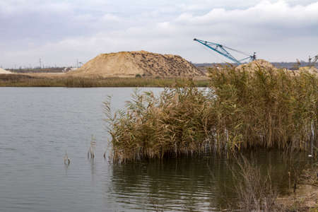Artificial reservoir in the worked out space of a clay quarry. Zaporozhye region, Ukraine. November 2017