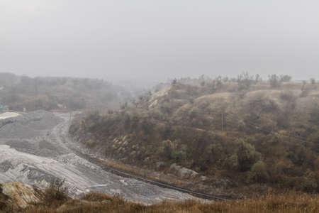 Clay quarry in the autumn fog. Haze. Zaporizhzhia region, Ukraine. November 2017