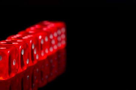 red casino dices on the black background.