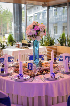 wedding decoration flowers in glass blue vase at the restaurant