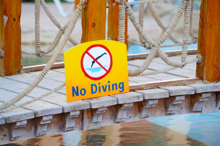 warning sign No Diving on the bridge over the hotels pool