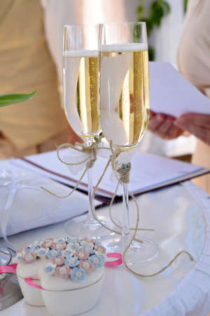 two wedding sparkling glasses with champagne and flowers