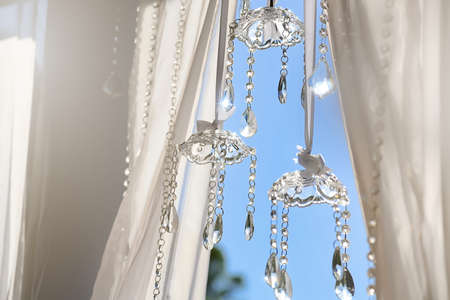 wedding decoration elements, sparkling crystal beads on a sky background Foto de archivo - 102669937