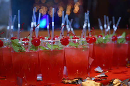 holiday red cocktails with cherry and mint for Christmas party Zdjęcie Seryjne