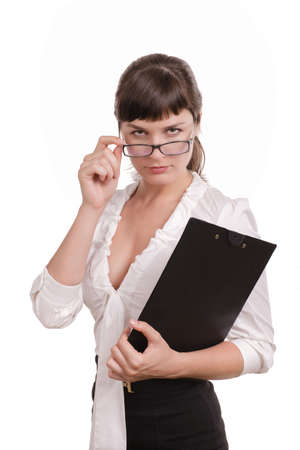 frowns: business woman with dark hair, wearing glasses with a folder and pen stands, frowns