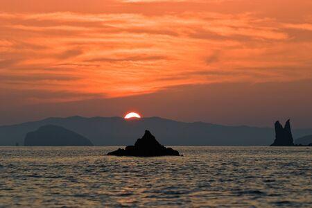 descends: wonderful landscape, the crimson sun descends to the sea