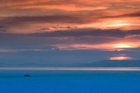 beautiful winter crimson sunset on a frozen sea Stock Photo