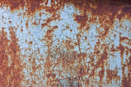 deteriorate: part of the metal wall with rusty stains