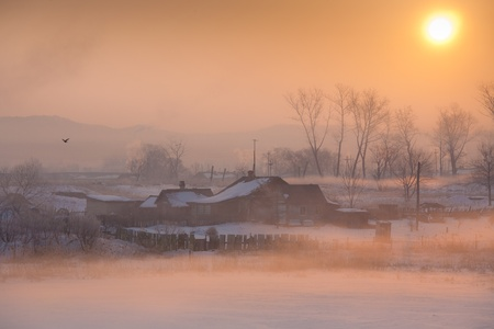 village houses in the background of a beautiful winter sunrise photo