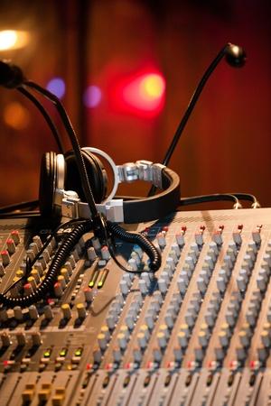 DJ mixer and headphones in a nightclub