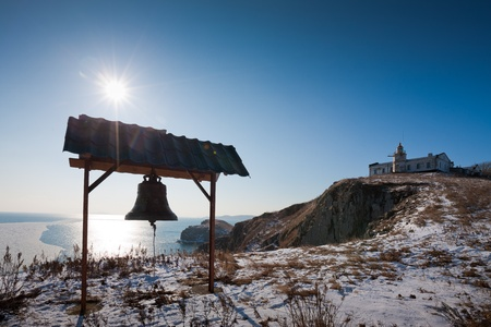 old bell on the beach at the lighthouse Stock Photo - 9290333