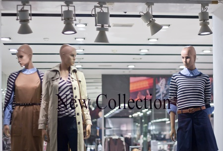 Glass storefront with mannequins photo