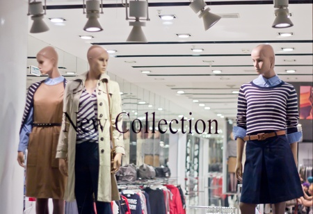 window shopper: Glass storefront with mannequins Stock Photo