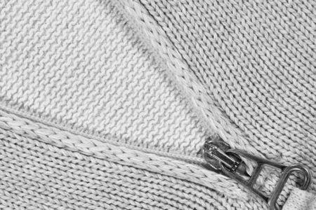 metal lock on a gray knitted sweater Stock Photo - 9403217