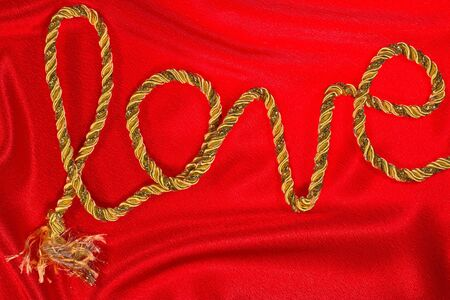 love the inscription in gold thread on red satin photo
