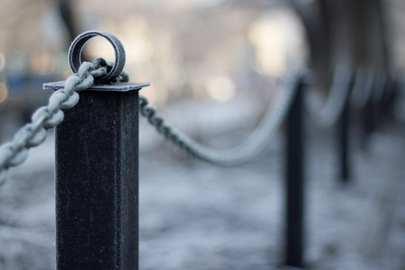 part prison: chain covered with frost on the street