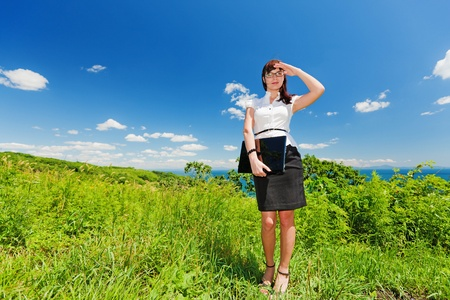 beautiful slender girl with a laptop on the nature photo