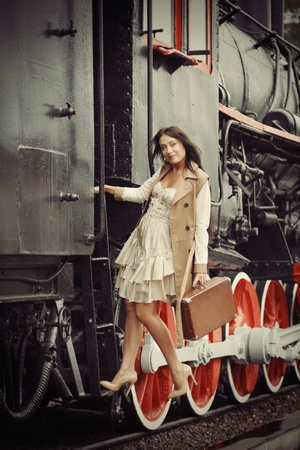 tourists stop: girl on the platform in the vintage train
