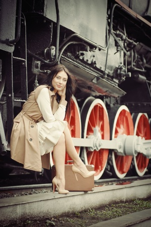 girl waiting for landing on the platform in the vintage train