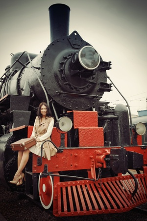girl travels to a vintage train photo