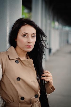 brunette girl standing on the platform photo