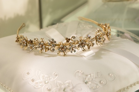 gold wedding tiara on a white pillow photo