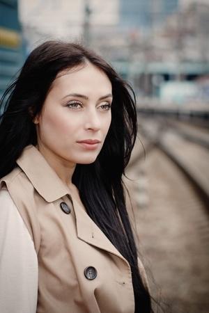 girl waiting for train on platform photo