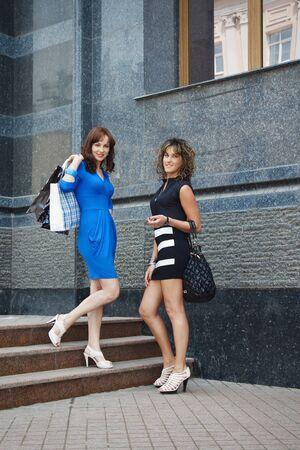 go shopping: Two young girls go shopping Stock Photo