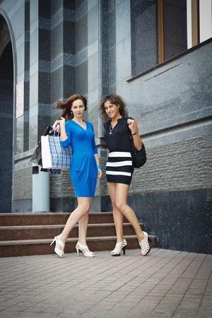 go shopping: two beautiful girls go shopping
