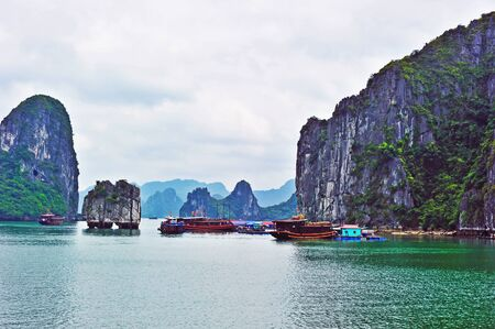 Vietnam Halong Bay in the fog photo