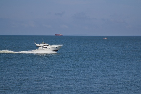 boat is speeding along coastal waters photo