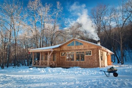 lodge: a small wooden house in a snowy forest Stock Photo