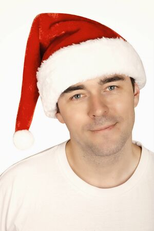 A young man with a beard in a red Christmas hat Stock Photo - 12047887