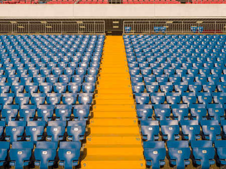 Rows of spectator seats at a football stadium