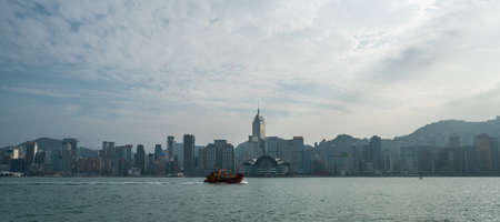 Hong Kong - 2020: panoramic view of Victoria Harbor and skyscrapers of the north coast of Hong Kong Island. Boat in the bay. Editoriali