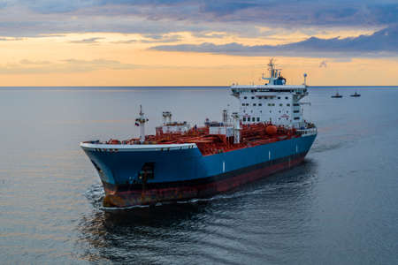 Tanker at sea, aerial view. Large blue and white ship in the bay at sunset. Landscape from above. Archivio Fotografico