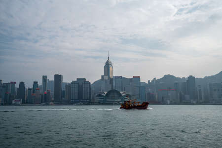 Hong Kong - 2020: view of Victoria Harbor and skyscrapers of the north coast of Hong Kong Island. Boat in the bay. Editoriali