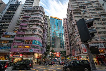 Hong Kong - 2020: Hong Kong streets, Lockhart Street and Stewart Road, typical residential buildings, Emperor Group Center office building.