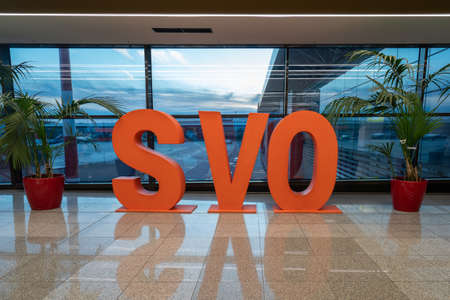 Moscow, Russia - 2020: Sheremetyevo International Airport, large orange letters SVO in the hall. Editoriali