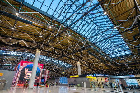 Moscow, Russia - 2020: interior of Sheremetyevo International Airport, Terminal C. Spacious hall, high ceilings with glazing. Passengers at the airport.
