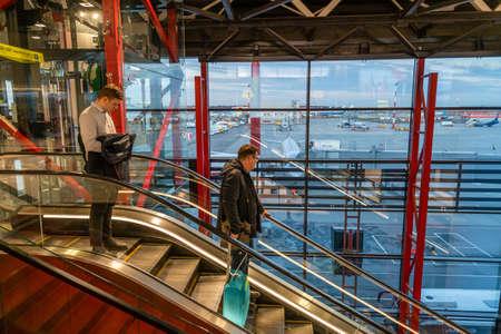Moscow, Russia - 2020: Sheremetyevo International Airport, passengers descending on an escalator.