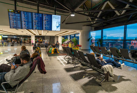 Moscow, Russia - 2020: Sheremetyevo International Airport, inside the terminal, people in waiting room.