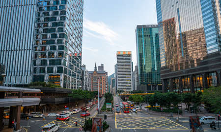 Hong Kong - 2020: Harbor Rd and Fleming Rd from above, yellow road markings, transport, park, modern buildings - Podium, Central Plaza, Everbright Center, Tung Wai Commercial Building, the church. Editoriali