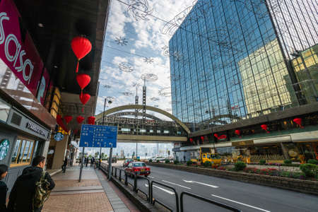 Hong Kong - 2020: Mody Lane by day, road and cross bridge between Empire Center and Tsim Sha Tsui Center, garlands and red chinese lanterns are above the street. Editoriali