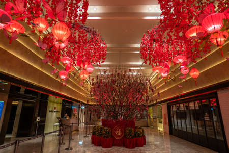 Hong Kong - 2020: New World Tower hall, red chinese lanterns with butterflies under the ceiling, a beautiful composition for interior decoration for the Chinese New Year.